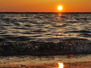 long sleeve one piece sunset